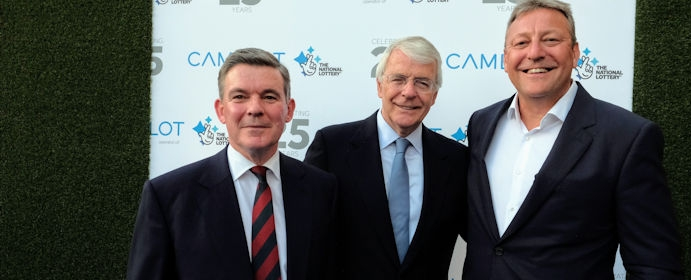 Sir Hugh Robertson welcomes Sir John Major to Camelot's 25th National Lottery anniversary celebration